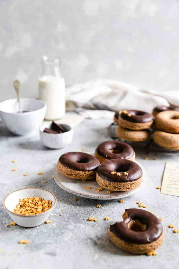 small plate with 3 baked doughnuts with chocolate glaze