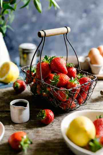 small wire basket filled up with fresh strawberries