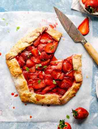 top view of strawberry galette with one slice cut off