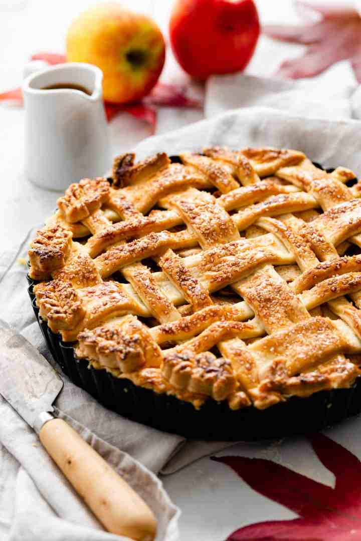a side close up of baked apple pie with lattice top