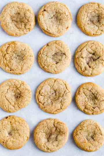 top view of rows of cookies on a baking parchment