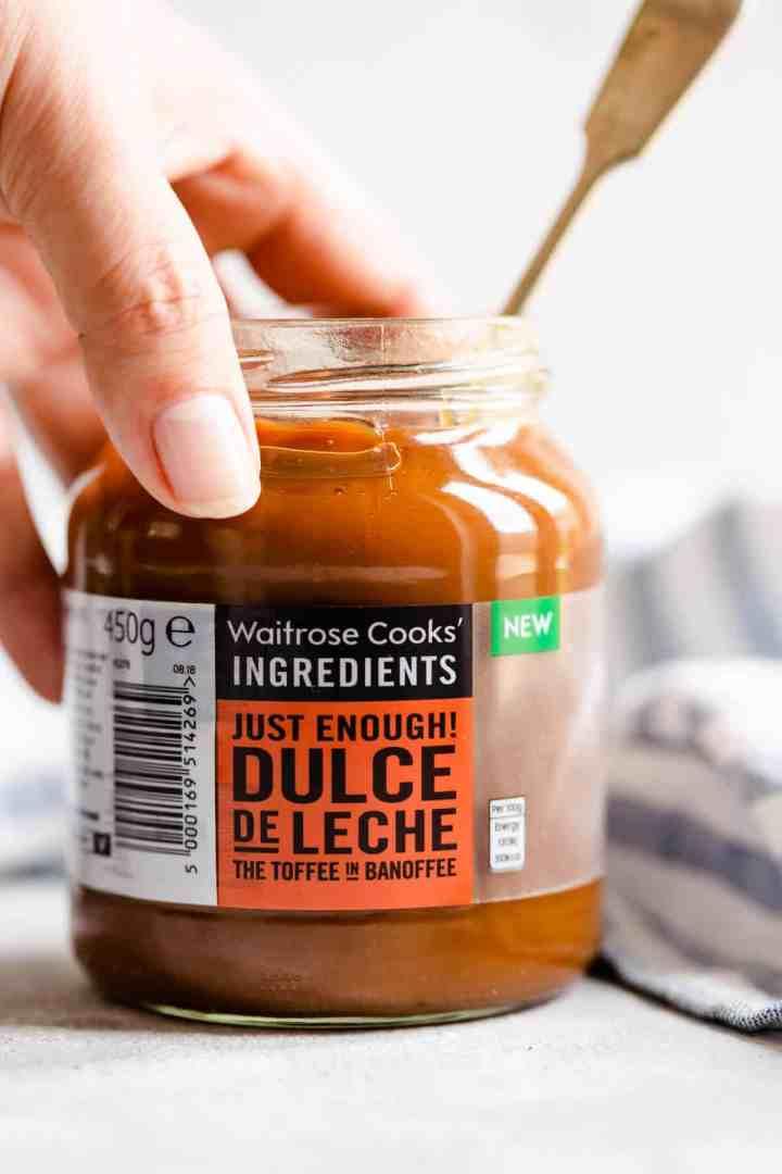 a close up of a jar of dulce de leche