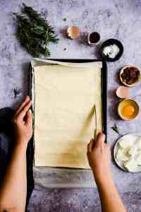 overhead shot of a person scoring puff pastry