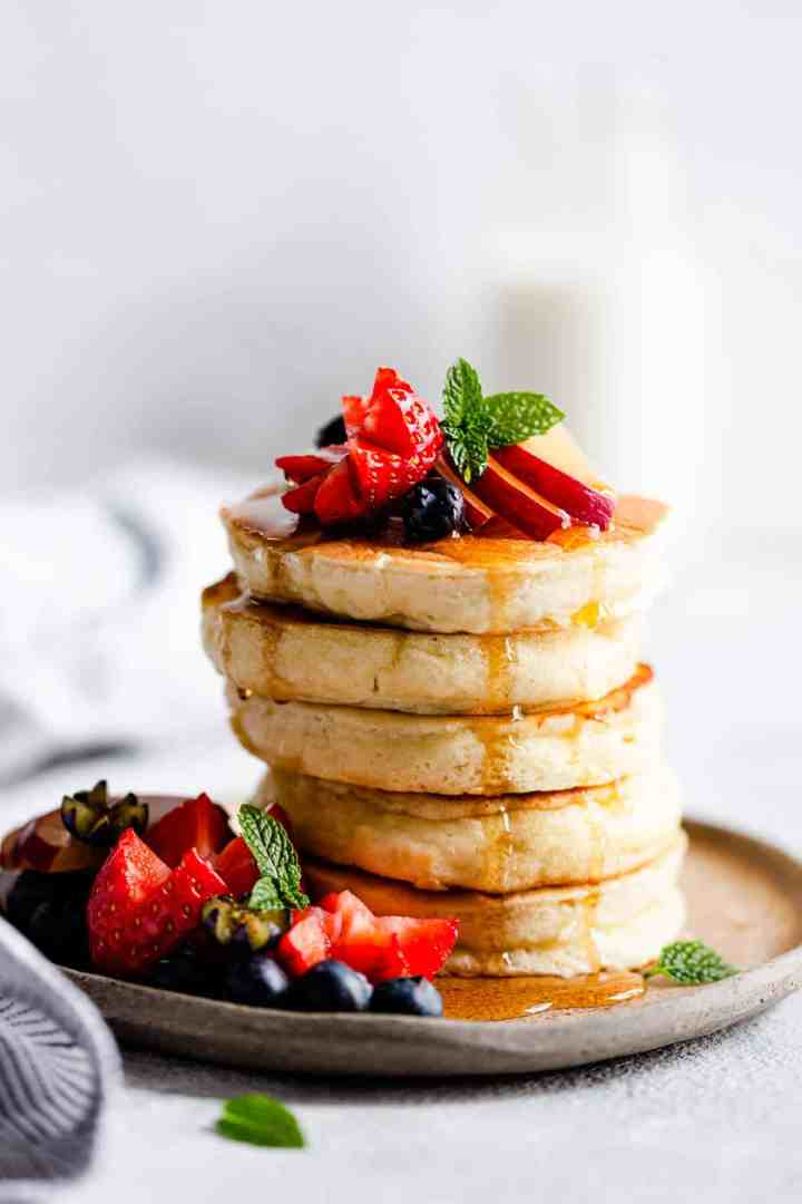 side close up of a stack of 5 fluffy pancakes