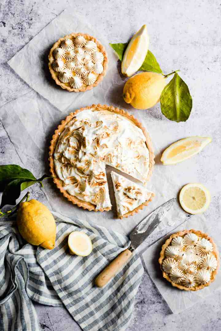overhead shot of a lemon pie with slice cut out