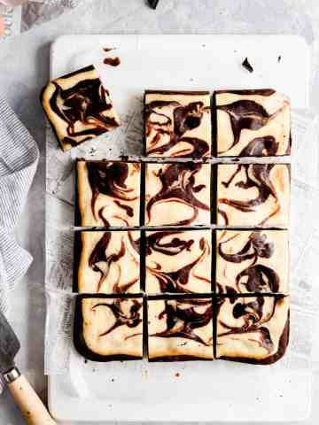 overhead shot of cheesecake brownies cut into 12 squares