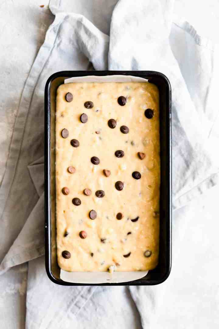 overhead shot of a loaf tin with banana bread batter inside