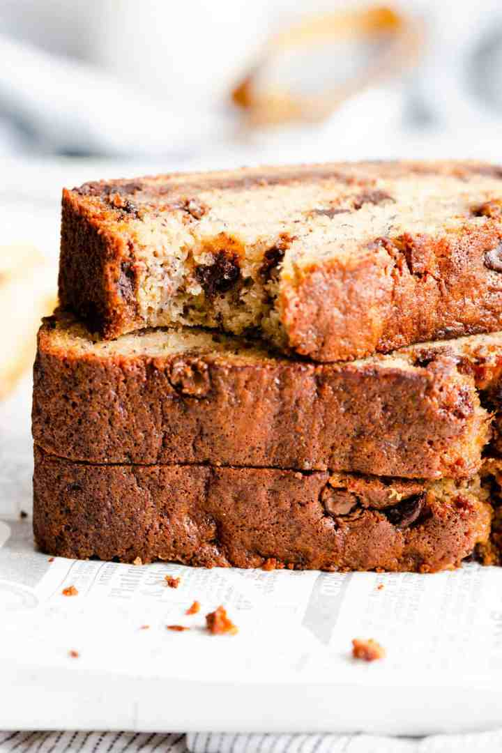 side close up of 3 slices of banana bread stacked on top of eachother