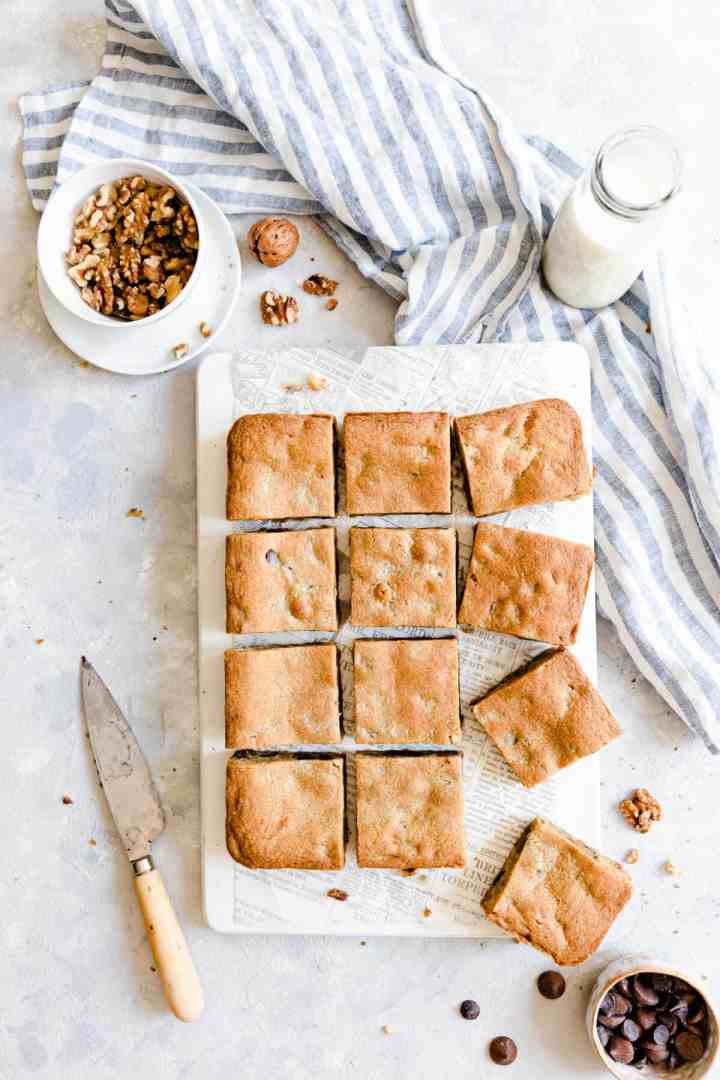 top view of individually sliced blondie bars on chopping board