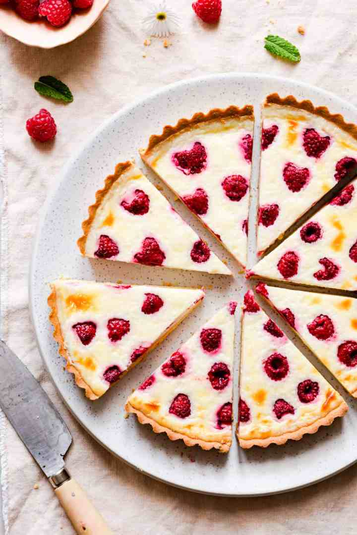 top view close up of slices of raspberry tart arranged in a circle