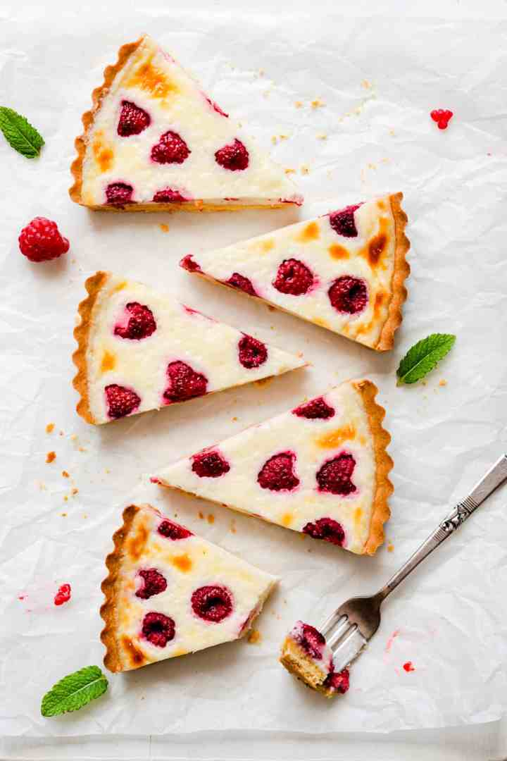 overhead view at 4 individual slices of raspberry mascarpone tart