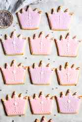 overhead view of sugar cookies decorated with pink and purple icing
