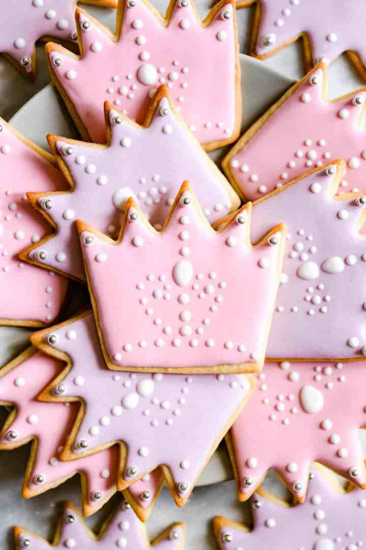 super close up at crown-shaped sugar cookies with royal icing