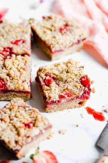 side close up of a square slice of strawberry crumble