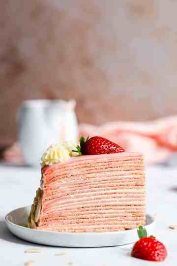 super close up of a slice of crepe cake on a small plate