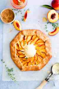 overhead shot of peach galette with a scoop of ice cream on top