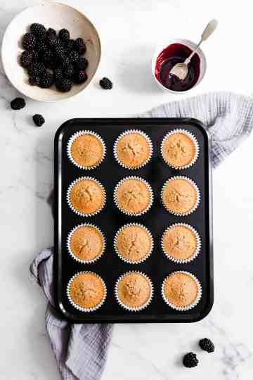 top view of a baking tray with spiced apple cupcakes inside