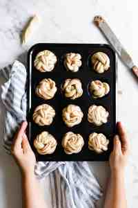 top view of a muffin tray filled with unbaked cinnamon buns
