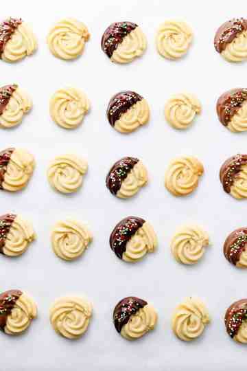 overhead shot of rows of Danish butter cookies decorated in different ways