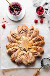 top view of a star-shaped bread with icing sugar on top