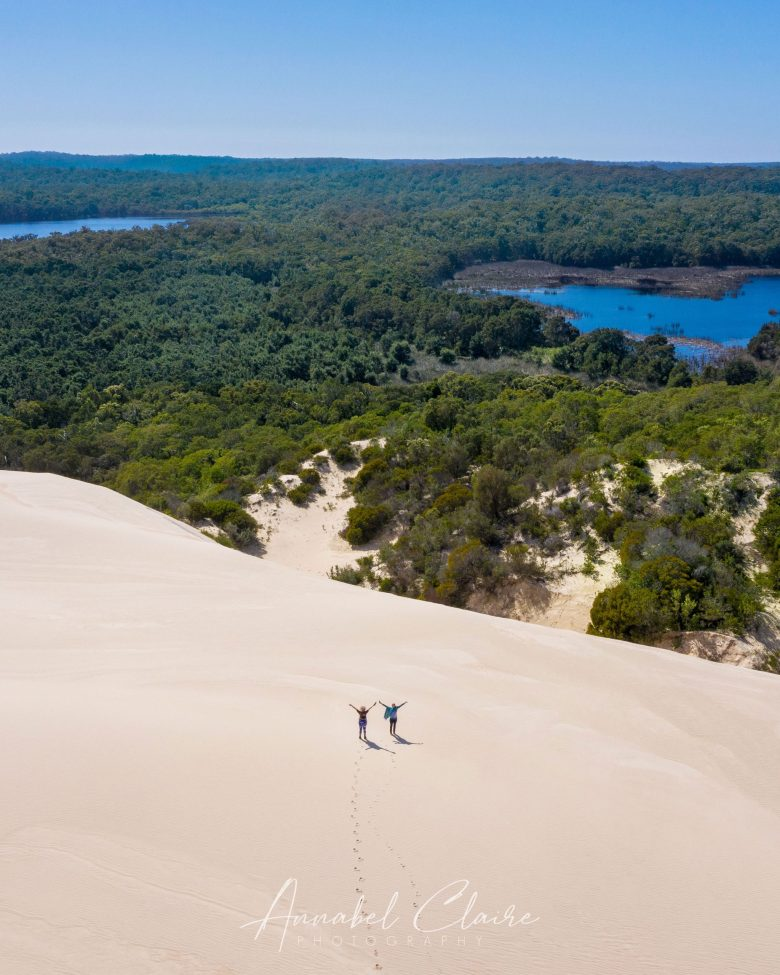Two people stand on Yeagarup Dunes to show proportion and their huge size