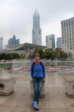 Ben by a musical fountain in Shanghai