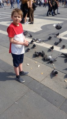 Gabriel feeding the pigeons by the Duomo in Milan