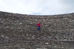 Anna climbing the wall at the stone fortress