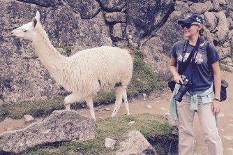 Trying my best to pose for a photo while also keeping my eye on the llama, Machu Picchu, Peru