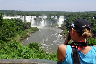 Anna taking a photo of Iguazu Falls, Brazil