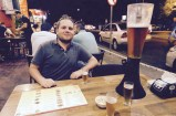 Matthew with our beer tower, Foz de Iguazu, Brazil