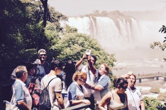 Matt and Ben trying to pose for a photo while everyone else has the same idea, Iguazu Falls, Brazil