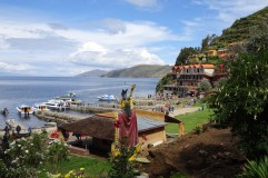 Ferries dropping off passengers on Isla del Sol, Lake Titicaca, Bolivia