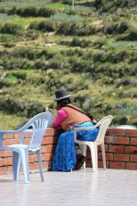 A local woman relaxing on Isla del Sol, Lake Titicaca, Bolivia
