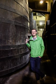 Ben with a big wine barrel (used for ageing) at Bodega Lopez, Maipu, Argentina