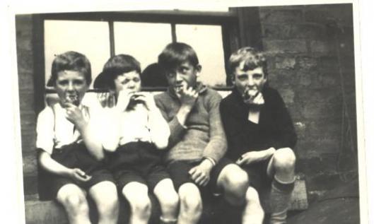 four kids eating apples