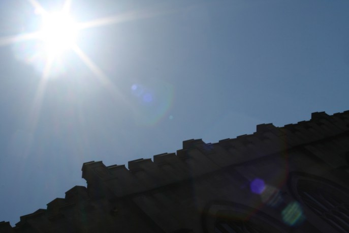 The sun over the edge of the chapel roof