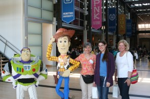 Pixar! Mother, me, and Aunt Sylvia standing next to Lego constructions of Woody and Buzz. =D