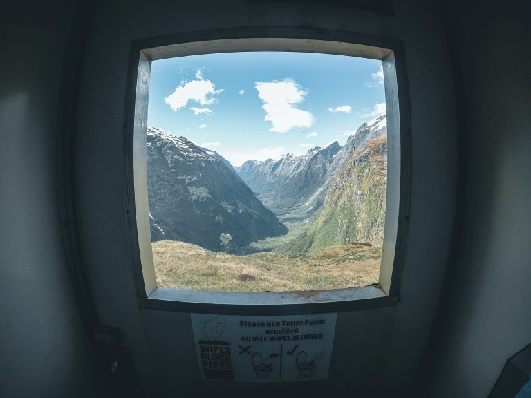 A square window overlooking a valley view from indoor