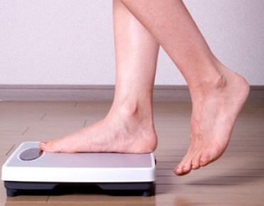 person stepping on scale