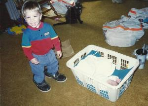 baby AnnaLeah and Levi in laundry basket