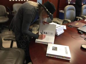 Marianne signing Vision Zero Petition Books at DOT 2