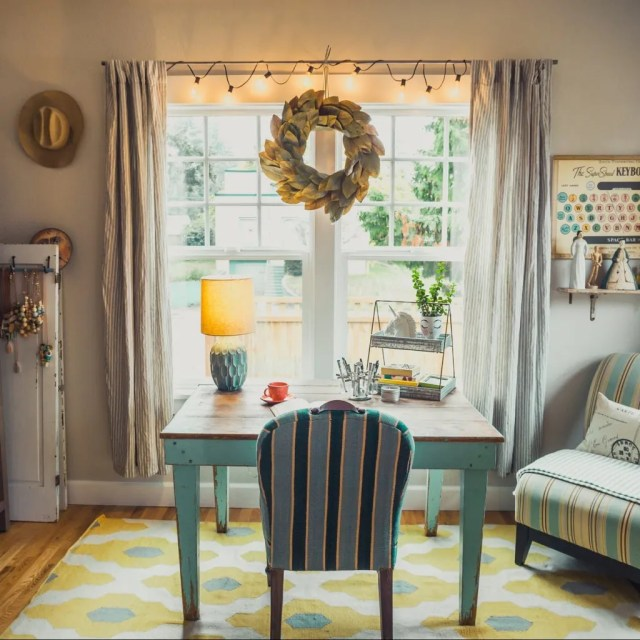 beige table lamp on table with chair in room