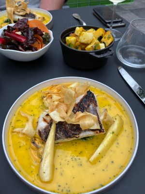 Fish off the bone of the day, pan fried hake with a beurre blanc sauce.