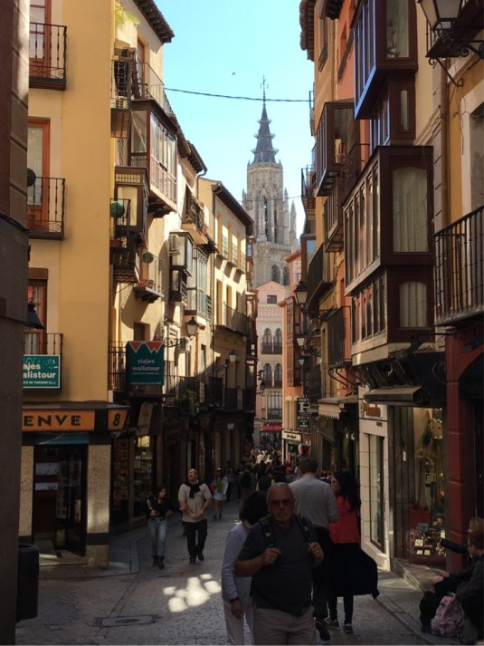Typical Toledo street with the Catedral in the distance.