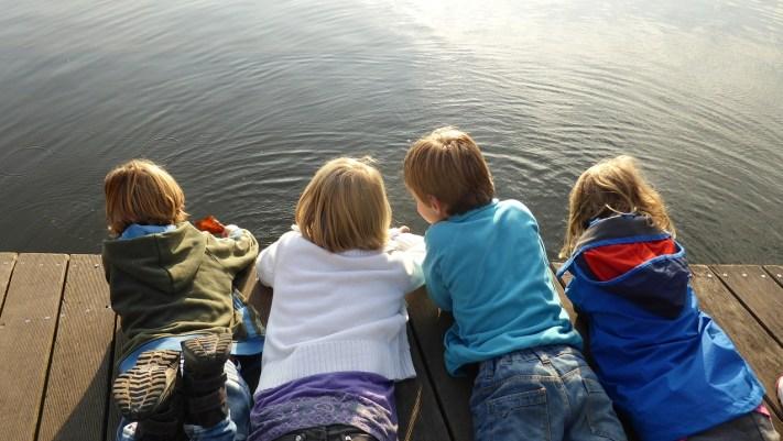 children by lake