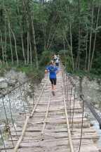trail running in nepal bridge corssing
