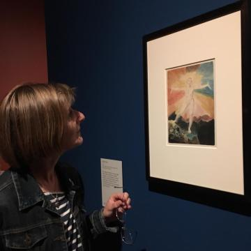 Anna looking at the William Blake image Albion Rose