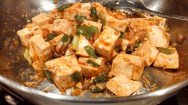 Stir to combine. Add the tofu and carefully stir until tofu is coated with the sauce.