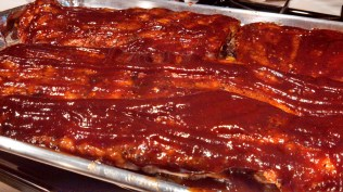 Remove from the oven after one hour and slather with your favorite barbecue sauce